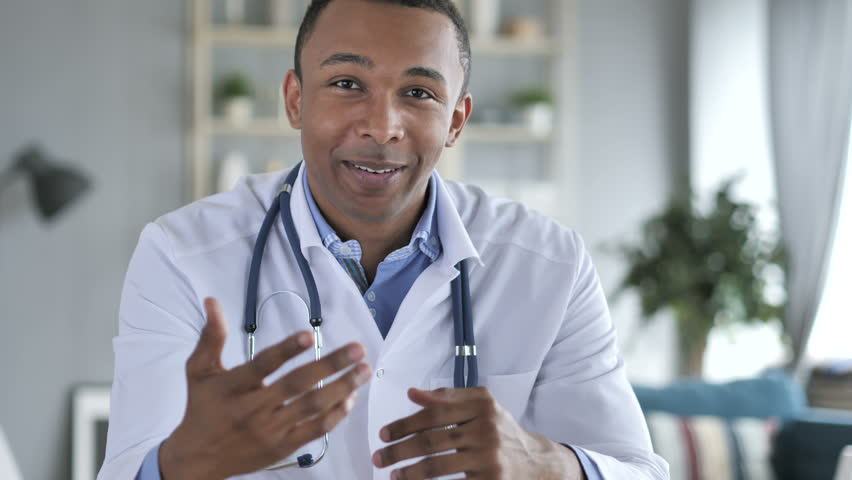Online Video Chat with Patient by African-American Doctor, Camera View