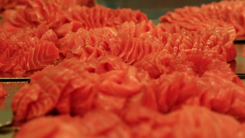 chef use knife to cutting fresh salmon fillet on chopping board to make salmon slices atlantic #1012799231