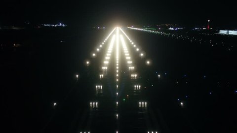 Airport, Air Traffic Control Tower and Airfield at Night.