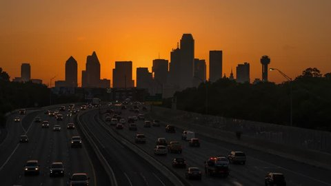 Dallas skyline sunrise time-lapse w/ highway traffic and a few clouds