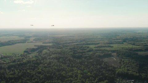 Glider Towing Plane. Sailplane airplane in flight at summer day. aerial cinematic view