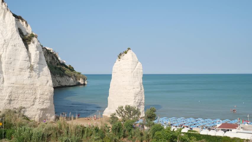 Beach of Pizzomunno famous white rock, in Vieste, Gargano coast, Puglia, Italy.