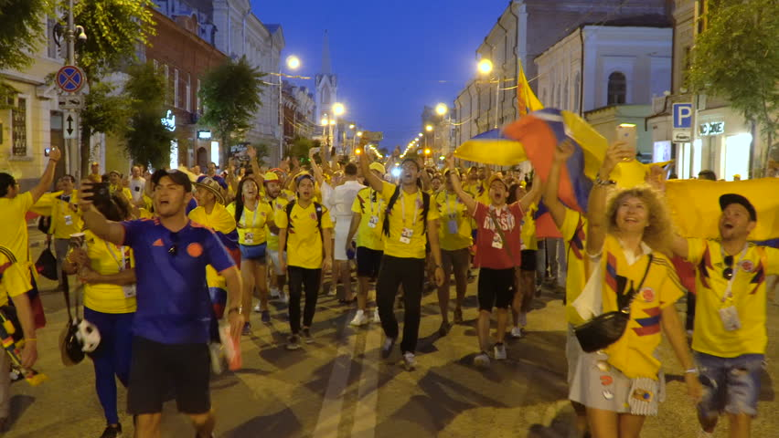 SAMARA - JUNE 28, 2018: Colombia football fans celebrating the victory of Colombia team at World Cup 2018 at night on June 28, 2018 in Samara, Russia.