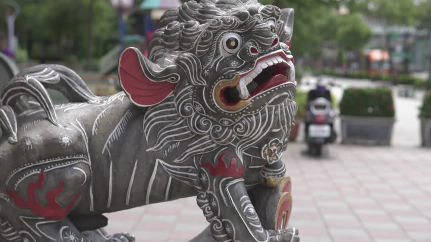 Stone lion and classical architecture in Asian temple.The landscape of Chinese traditional building.