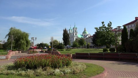 Public park at the Soviet square with the St. Francis Xavier Cathedral at background.  Grodno, Belarus
