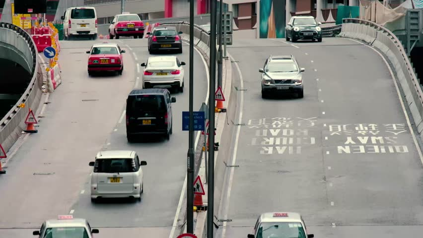 Time lapse of traffic on the streets Hong Kong city at Central.  | Shutterstock HD Video #1012990541
