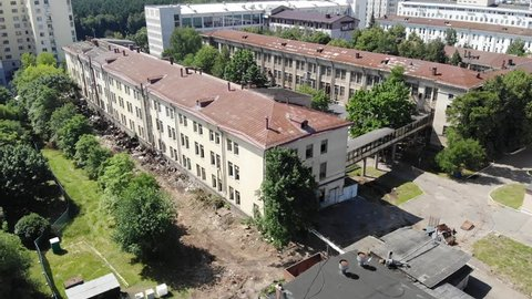 Aerial view from the air to an abandoned factory. Old industrial building for demolition. Abandoned building exterior.