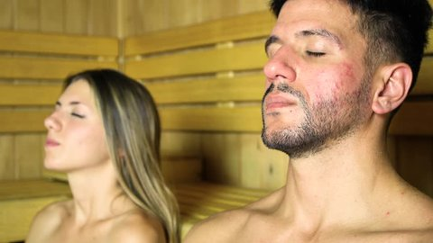 Couple relaxing in a sauna