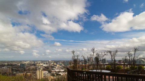 UHD 4k time lapse of moving white clouds and blue sky over downtown Portland Oregon cityscape with steel tied arch Fremont Bridge 4096x2304