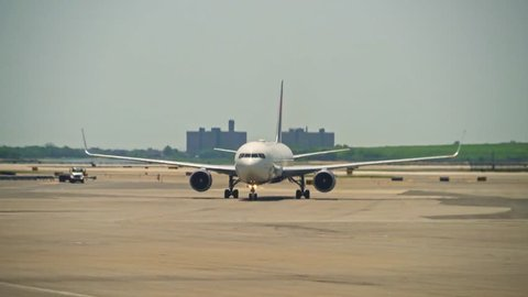 New York, United States, June 10, 2018: Big passenger plane driving towards the gate at a large international airport