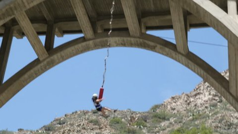 Girl Screaming and Bungee jumping off of bridge to nowhere