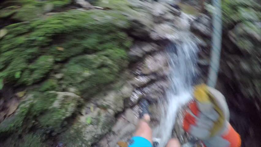 Man rapels down waterfall in Costa Rica POV