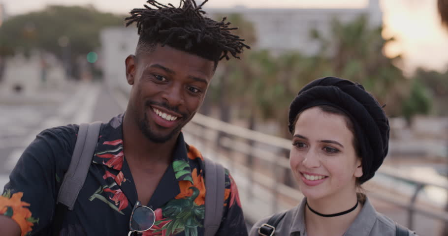Portrait happy multi ethnic couple using smartphone taking selfie photo smiling enjoying vacation together slow motion real people series | Shutterstock HD Video #1013106011