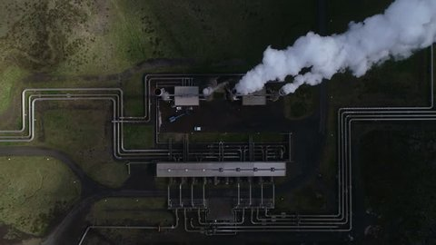 Aerial footage of a clean energy power plant in Iceland producing heat and electricity with geothermal power