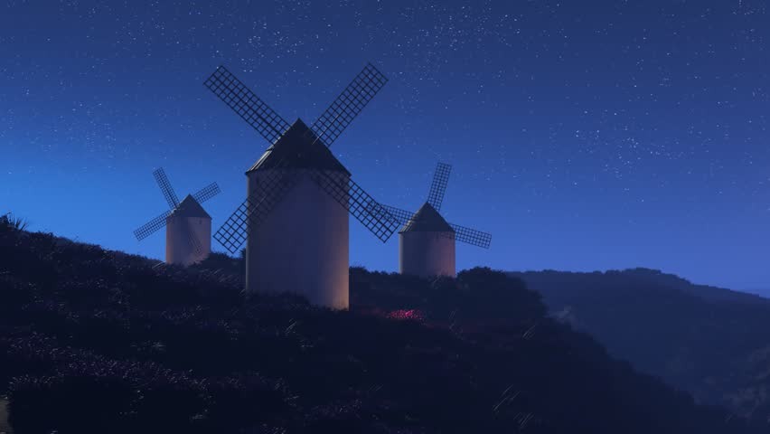 03493 Vintage agriculture windmills rotating slowly at night with stars in the background.