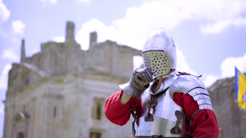 Portrait close up of medieval knight wearing traditional steel armor. Fantasy and reenactment | Shutterstock HD Video #1013186411