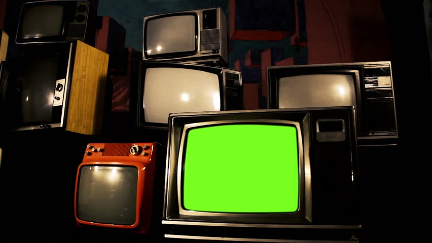 "Old TV Green Screen among different Retro TVs. Red Tone. You can Replace Green Screen with the Footage or Picture you Want with ""Keying"" effect in After Effects (check out tutorials on YouTube).  