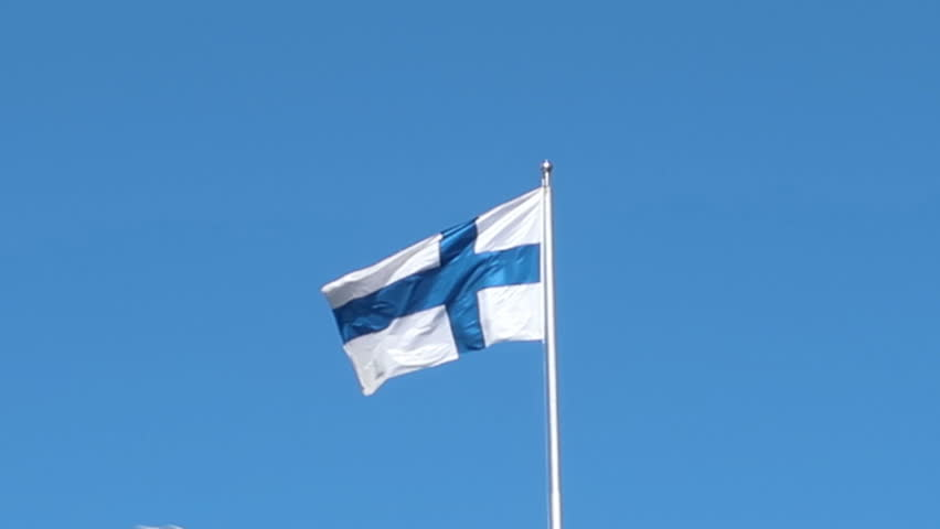 Helsinki, Finland,june 2018, finnish flag in the wind on blue sky ground