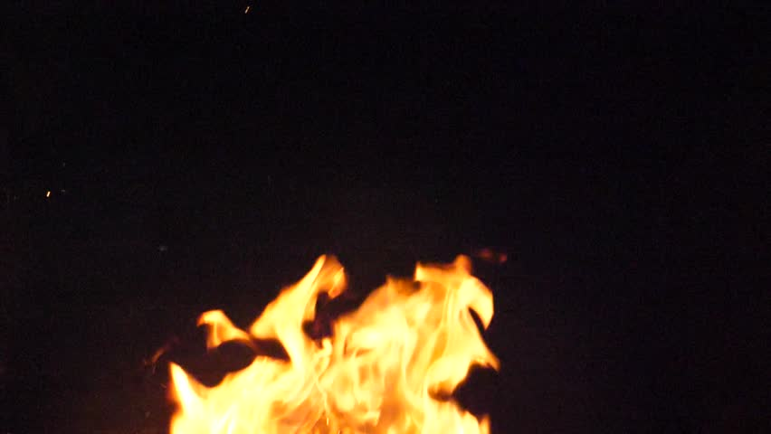 Slow motion fire. Fireplace burning. Warm cozy burning fire in a brick fireplace close up. Cozy background. Dance of Fire