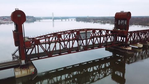 BURLINGTON, IOWA - CIRCA 2017 - Aerial shot of a railroad drawbridge lifting or raising over the Mississippi River near Burlington, Iowa.