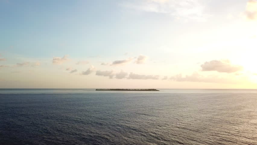 Aerial view of a remote island at sunset in Wakatobi National Park in Indonesia. This region harbors extremely high marine biodiversity and is a popular destination for scuba diving and snorkeling.