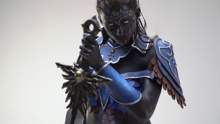Cool cosplay of a dark elf, a black girl with white eyes. Slow motion | Shutterstock HD Video #1013466791