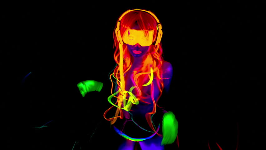 Fantastic video of sexy cyber raver dancer babe filmed in fluorescent clothing under UV black light | Shutterstock HD Video #10135193
