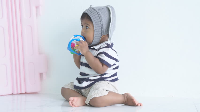 Cute asian baby boy bite toy