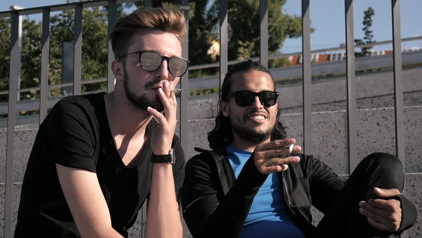Two Boys Friends smoking Cigarettes on a City Quay - Hot Summer Day | Shutterstock HD Video #1013580041