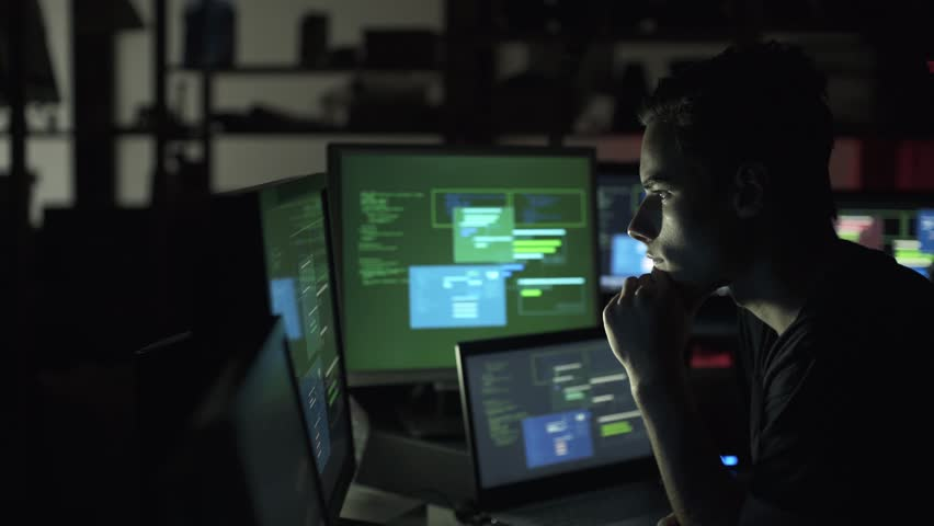 Nerd developer working late at night in his basement and hacking networks, cyber crime and coding concept | Shutterstock HD Video #1013580611