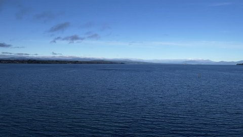 Scenic view of Tongariro national park from lake Taupo the largest fresh water lake in New Zealand.