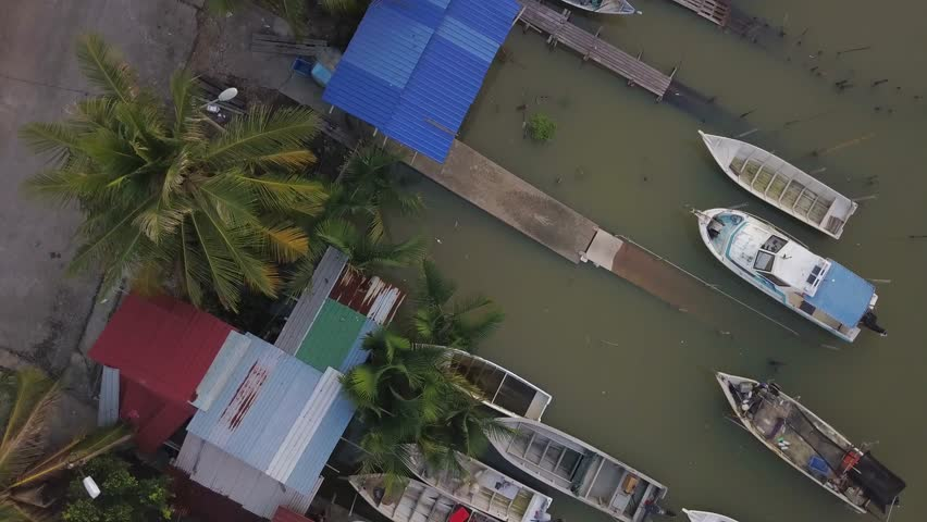 Fine art footage, Aerial view of Fisherman jetty at Kelanang beach, Malaysia during sunset. 4k | Shutterstock HD Video #1013591861