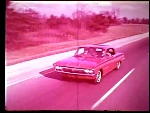 Circa 1960s - the turbo rocket v8 engine in the oldsmobile jetfire is  presented