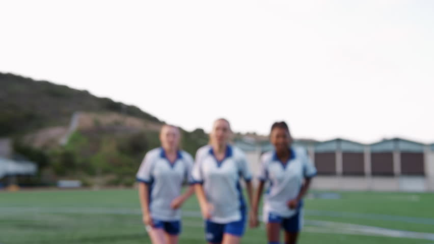 Portrait Of Female High School Soccer Team Running Towards Camera And Celebrating   Shutterstock HD Video #1013598671