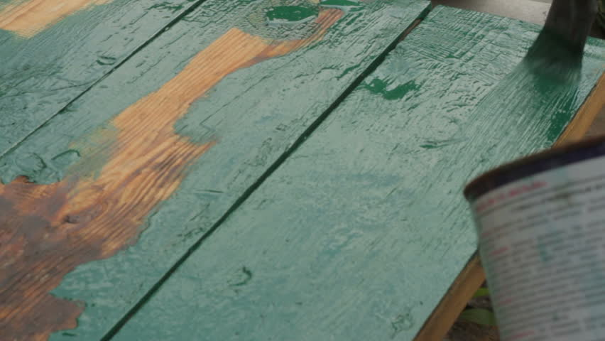 Macro shot of restorer restoring a wooden table varnishing with a green color. | Shutterstock HD Video #1013635721