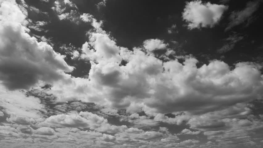 The clouds are moving in the blue sky. Black and white.  | Shutterstock HD Video #1013640191