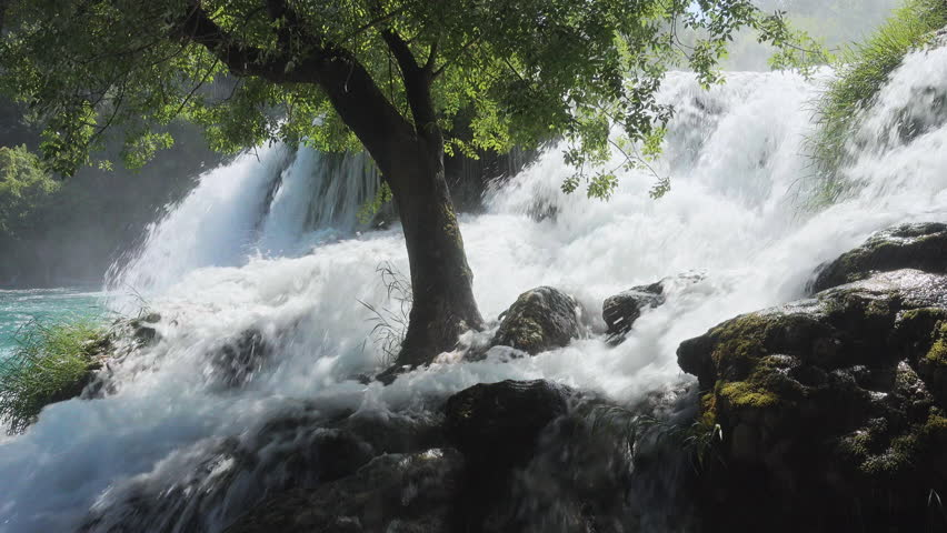 Skradinski buk the most unusual waterfall in Krka National Park. Location place Skradin resort (Lozovac), Croatia, Europe. Scenic footage of travel destination. Beauty of earth. Shooting in 4K video. | Shutterstock HD Video #1013644781