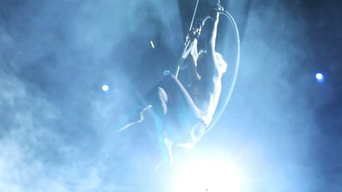 Young girl performs the acrobatic elements in the air ring