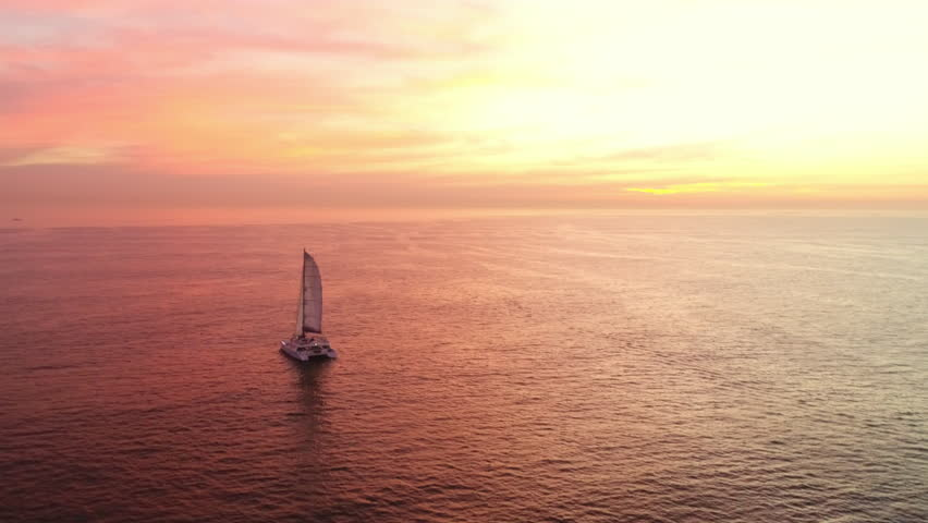 Yachting along the coast line of Cape Town with a dramatic sunset as backdrop | Shutterstock HD Video #1013688911
