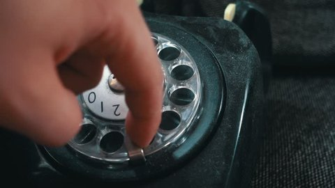 Calling on an old vintage rotation phone and dialing a number