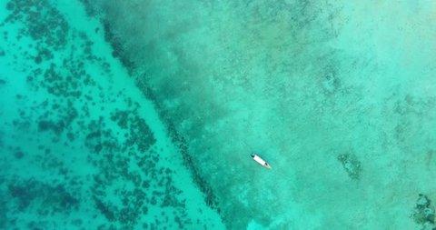 Aerial shot of a boat near the Bawe Island, Zanzibar.