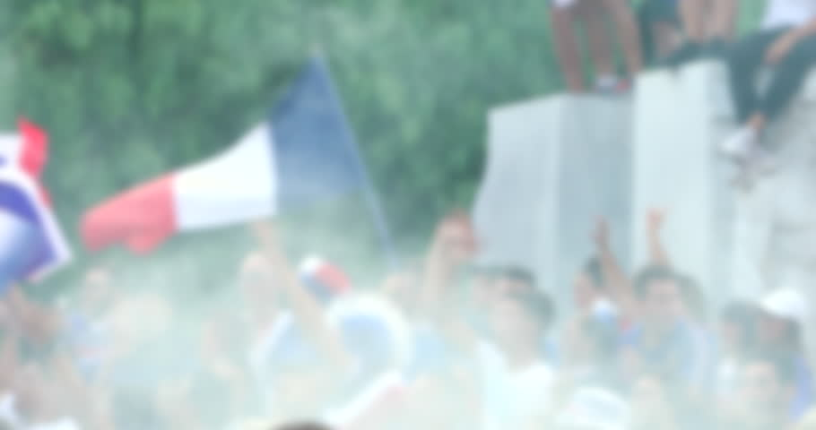 Blurred Background Of Crowd Of French Supporters With Tricolor Flag Celebrate In The Street After Winning The World Cup - DCi 4K Resolution | Shutterstock HD Video #1013738111