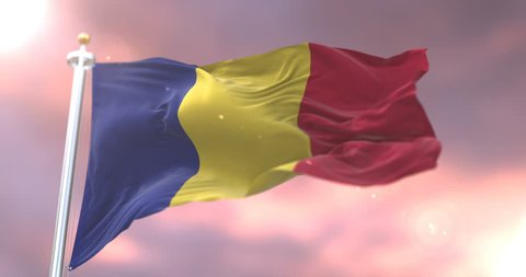 Romania flag waving at wind in slow with blue sky, loop