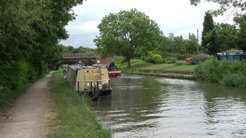 Beautiful landscape with coventry canal  around Tamworth, UK with running boat.