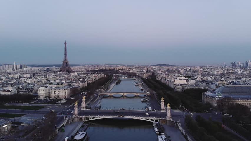The river Seine in Paris before sunrise. The Eiffel tower can be seen in the back. The bridge Alexander can be seen in the foreground. | Shutterstock HD Video #1013775491