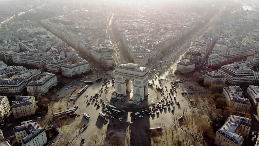Aerial shot of the Arc de Triomphe and the traffic around it. Cars drive on the Champs Elysees. Paris in morning light. | Shutterstock HD Video #1013777141