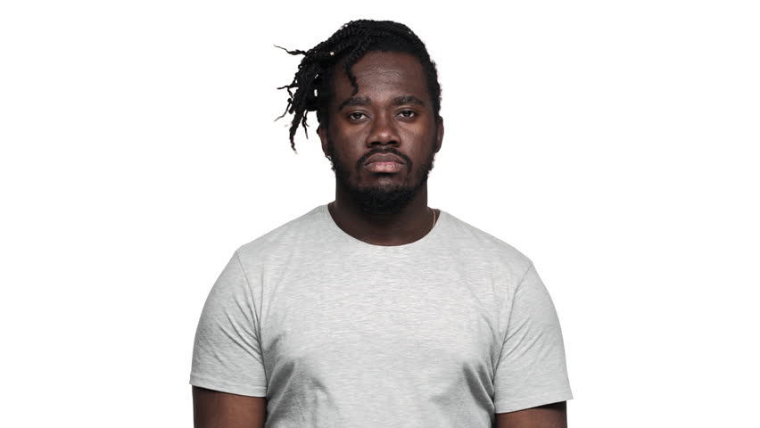 Portrait of helpless african american man with afro pigtails throwing hands aside and shrugging don't know or can't help slow motion, isolated over white background. Concept of emotions