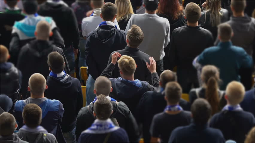 People in fan zone start applauding their sports team, supporters at stadium. Many football fans clapping hands, excited crowd, slow motion | Shutterstock HD Video #1013854691