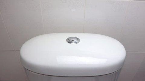 Men press on  button toilet flushing. Flush toilet, toilet flush handle.