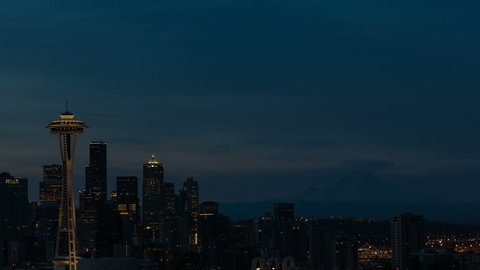 Ultra high definition 4k time lapse movie of  moving clouds and sky over downtown urban cityscape in Seattle WA from early morning dawn sunrise into daylight 4096x2304 uhd